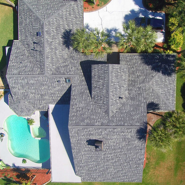 Top view of home roof with gray roofing tiles